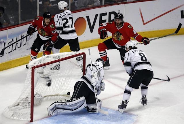 Chicago Blackhawks left wing Brandon Saad (20) scores a goal against Los Angeles Kings goalie Jonathan Quick (32) during the first period in Game 7 of the Western Conference finals in the NHL hockey Stanley Cup playoffs Sunday, June 1, 2014, in Chicago. (AP Photo/Charles Rex Arbogast)