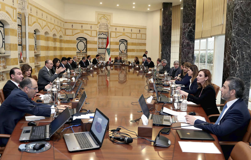 In this photo released by Lebanon's official government photographer Dalati Nohra, Lebanese President Michel Aoun, center, heads the cabinet meeting, at the presidential palace, in Baabda, east of Beirut, Lebanon, Tuesday, Feb. 25, 2020. French oil giant Total and the Lebanese government said Tuesday the drill ship that will carry operations of the first exploration well off the Lebanese coast has arrived where it will start drilling later this week. The arrival of the drill ship comes at a time when Lebanon is passing through its worst economic and financial crisis in decades and harsh liquidity shortage. (Dalati Nohra via AP)