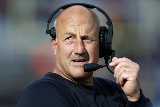FILE - In this Oct. 13, 2018, Boston College head coach Steve Addazio talks on his headset during the second half of an NCAA college football game against Louisville in Boston. (AP Photo/Michael Dwyer, File)