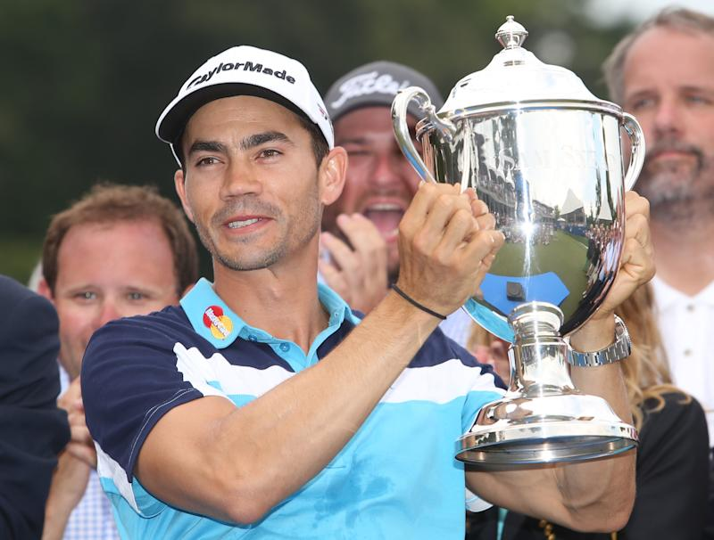 Camilo Villegas of Colombia poses with the Sam Snead Cup after winning the Wyndham Championship at Sedgefield Country Club on August 17, 2014 in Greensboro, North Carolina