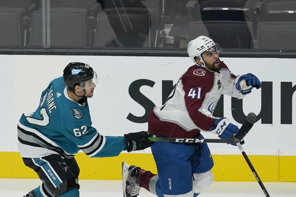 Colorado Avalanche center Pierre-Edouard Bellemare (41) looks toward the puck in front of San Jose Sharks right wing Kevin Labanc (62) during the first period of an NHL hockey game in San Jose, Calif., Monday, March 1, 2021. (AP Photo/Jeff Chiu)