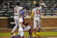 Atlanta Braves on-deck batter Freddie Freeman (5) greets teammate Ronald Acuña Jr. (13) after Acuña Jr. hit a solo home run during the fifth inning of the second baseball game of a doubleheader against the New York Mets, Monday, June 21, 2021, in New York. Mets catcher James McCann, center, looks on. (AP Photo/Kathy Willens)