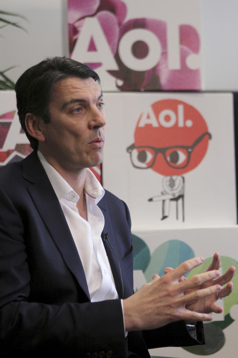 In this Friday, April 22 2011 photo, AOL CEO Tim Armstrong gestures during an interview with the Associated Press in the 100% room at AOL headquarters in New York. AOL Inc. said Wednesday, May 4, 2011, its first-quarter net income dropped sharply as the Internet company continued to see a drop in advertising and subscription revenue. (AP Photo/Mary Altaffer)