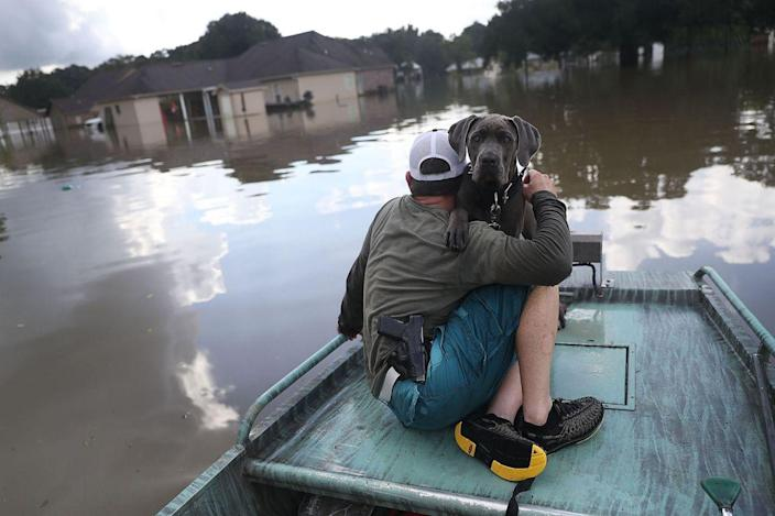 <p>AUG. 17, 2016 — Travis Guedry and his dog Ziggy glide through floodwaters keeping an eye out for people in need in Sorrento, La. (Joe Raedle/Getty Images) </p>