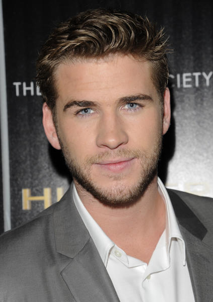 """Actor Liam Hemsworth attends a special screening of """"The Hunger Games"""" hosted by The Cinema Society and Calvin Klein Collection at SVA Theatre on Tuesday, March 20, 2012 in New York. (AP Photo/Evan Agostini)"""