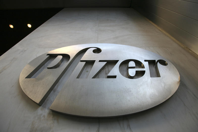 FILE - In this Jan. 25, 2009 file photo, a sign at Pfizer world headquarters in New York is shown. Pharmaceutical giant Pfizer Inc. said Tuesday, Nov. 2, 2010, revenue in the third quarter jumped 39 percent due to its acquisition of fellow drugmaker Wyeth, but hefty charges dragged its profit down 70 percent. (AP Photo/Mark Lennihan, file)
