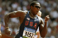 FILE - Shawn Crawford, gold medalist in the 200-meter competition at the Athens Games, competes in a heat of the men's 200-meter competition at the Beijing 2008 Olympics in Beijing, in this Monday, Aug. 18, 2008, file photo. Crawford ran track and Clemson University. Clemson track is one of the 85 Division I sports programs to be shuttered in recent years, a trend that picked up steam because of financial strains exposed during the COVID-19 pandemic. Olympic and college-sports leaders fear it will only continue as changes in the college system take hold. (AP Photo/David J. Phillip, File)