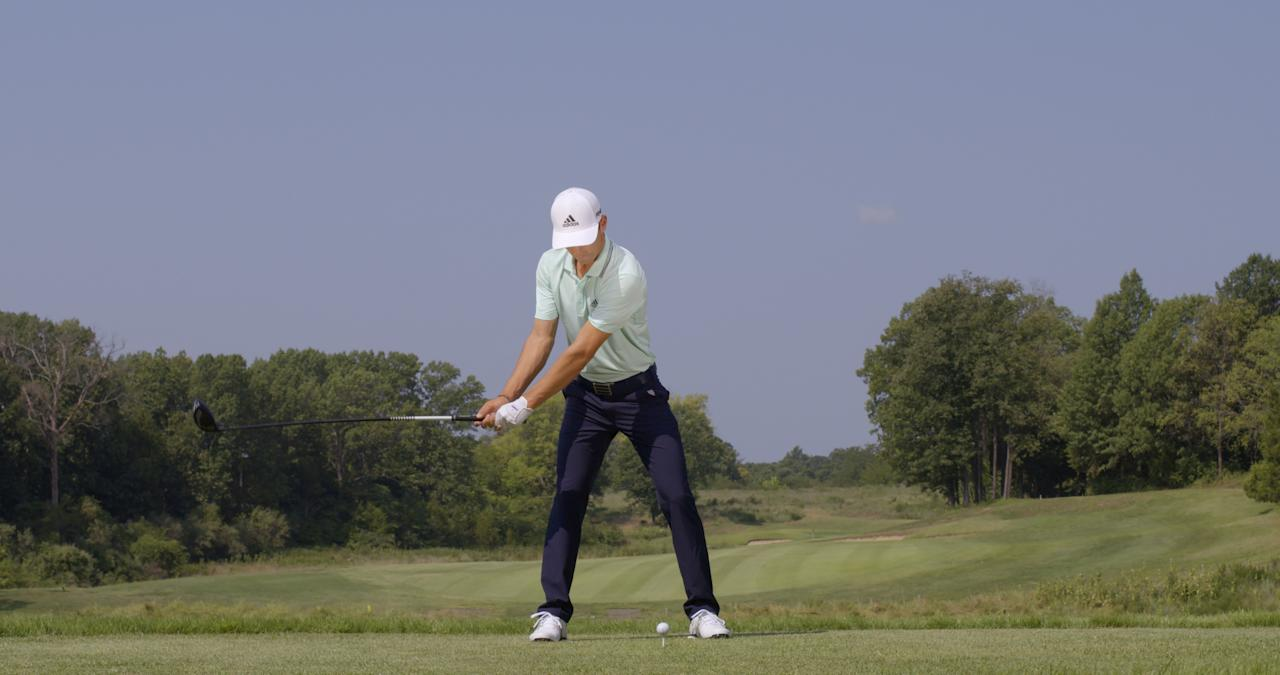 <p><strong>A BIG WINDUP</strong></p> <p>As he takes the club back, you can see how much his upper body has rotated by looking at his forearms—the right is above the left, McLean says. Though coiling is noticeable in his upper body, note how still and stable his lower body appears. This difference creates the potential for more distance.</p>