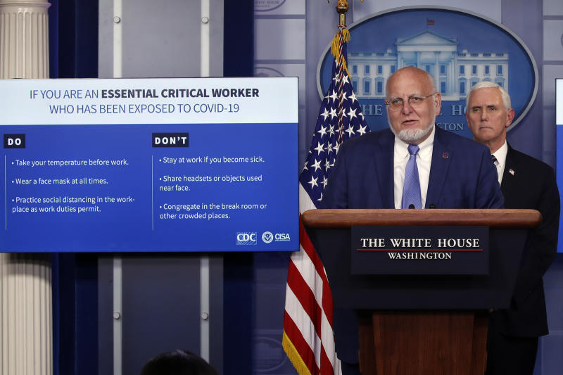 Dr. Robert Redfield, director of the Centers for Disease Control and Prevention, speaks as charts are displayed during a briefing about the coronavirus in the James Brady Press Briefing Room of the White House, Wednesday, April 8, 2020, in Washington, as Vice President Mike Pence listens. (AP Photo/Alex Brandon)