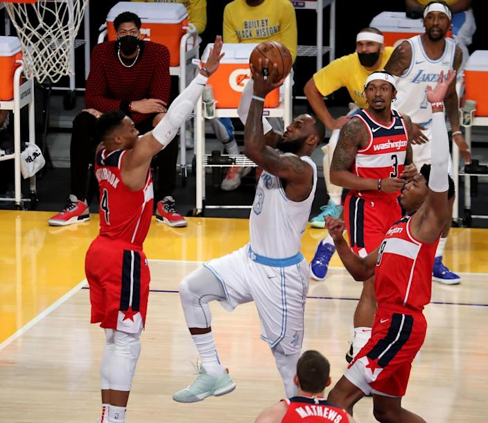 Lakers forward LeBron James slices to the basket against the Washington Wizards in the first quarter Monday.