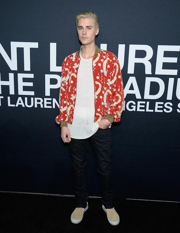 <p>A boldly patterned Saint Laurent bomber wouldn't be every guy's cup of tea, but Bieber pulled it off without breaking a sweat. <i>[Photo: Getty]</i></p>