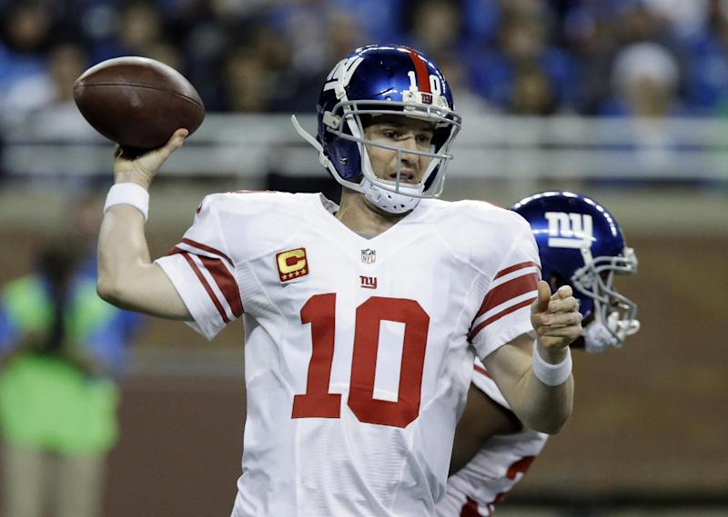 New York Giants quarterback Eli Manning (10) throws during the first quarter of an NFL football game against the Detroit Lions, Sunday, Dec. 22, 2013, in Detroit. (AP Photo/Duane Burleson)