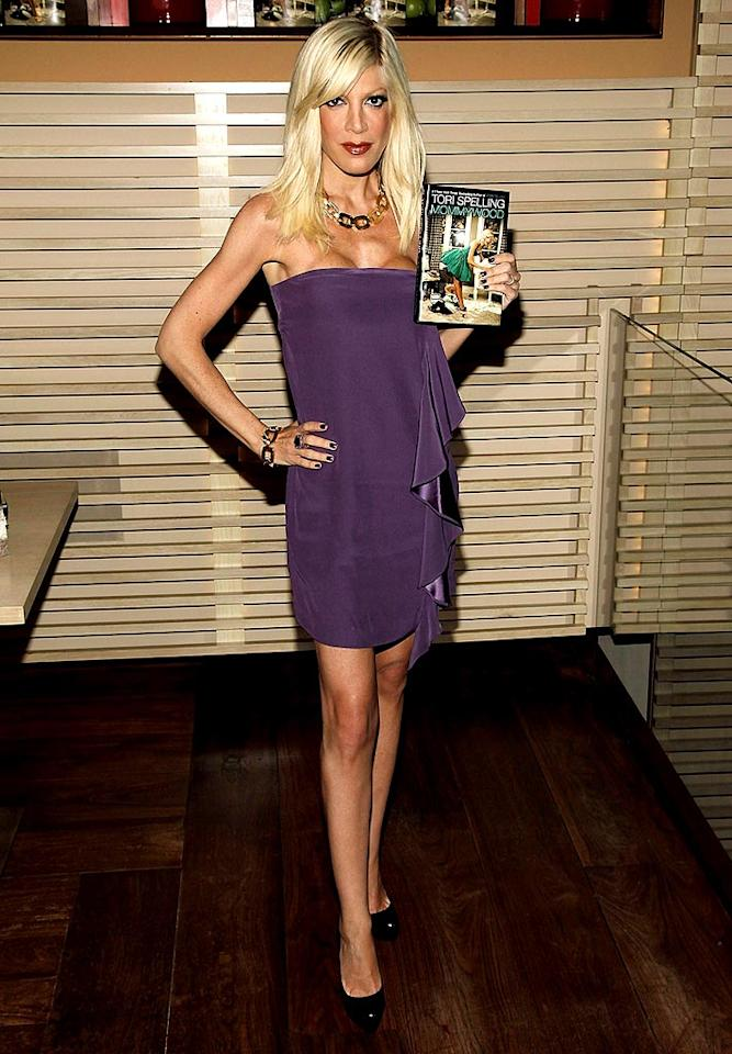 """Tori Spelling showed off her new book """"Mommywood"""" in New York City Wednesday. The actress/author/mother of two addressed rumors that she's anorexic, telling People, """"I acknowledge that I look thin in photos. I get it."""" She attributed her slim figure to her """"crazy lifestyle"""" and hectic schedule. Joe Kohen/<a href=""""http://www.wireimage.com"""" target=""""new"""">WireImage.com</a> - April 15, 2009"""