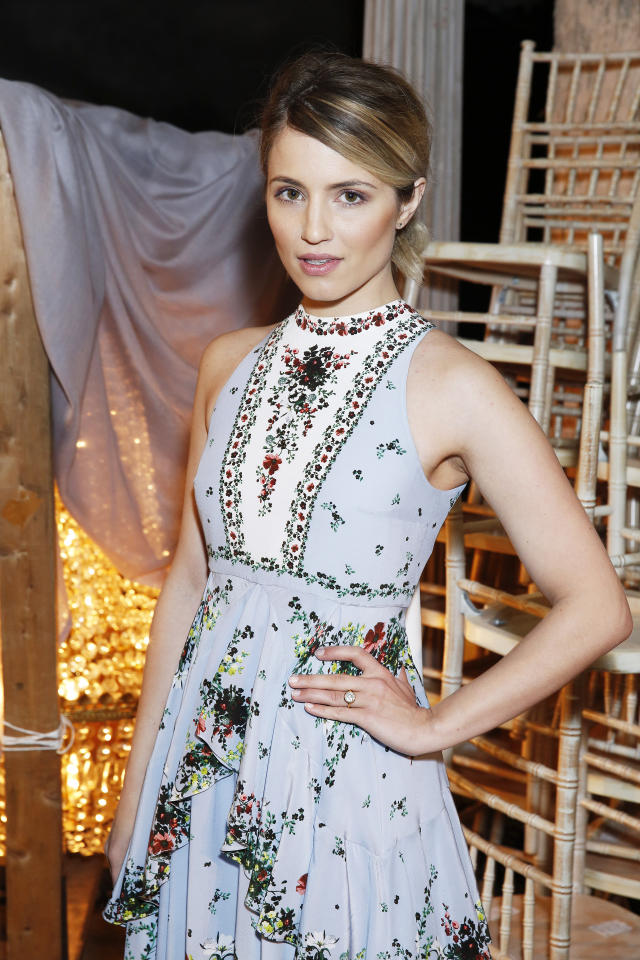 <p>The clothes at the Erdem Fall/Winter 2016 runway show during London Fashion Week were beautiful, but none of the looks were accessorized with massive diamond rings. Dianna Agron did just that, showing off her sparlker from fiancé Winston Marshall from her front row perch. (<i>Photo: Getty Images)</i></p>