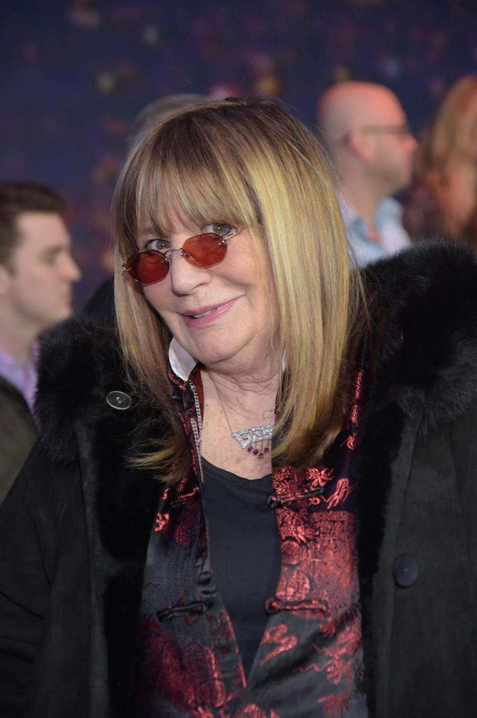 Penny Marshall channels Penny Lane with her round rose-colored glasses.