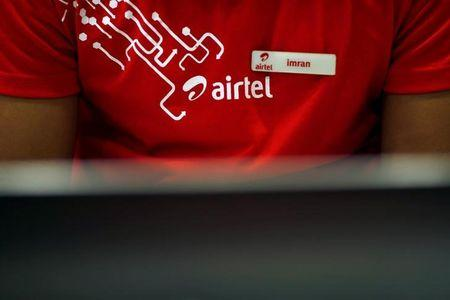 An employee works at a billing counter inside a Bharti Airtel store in New Delhi, India April 20, 2016. REUTERS/Adnan Abidi/File Photo