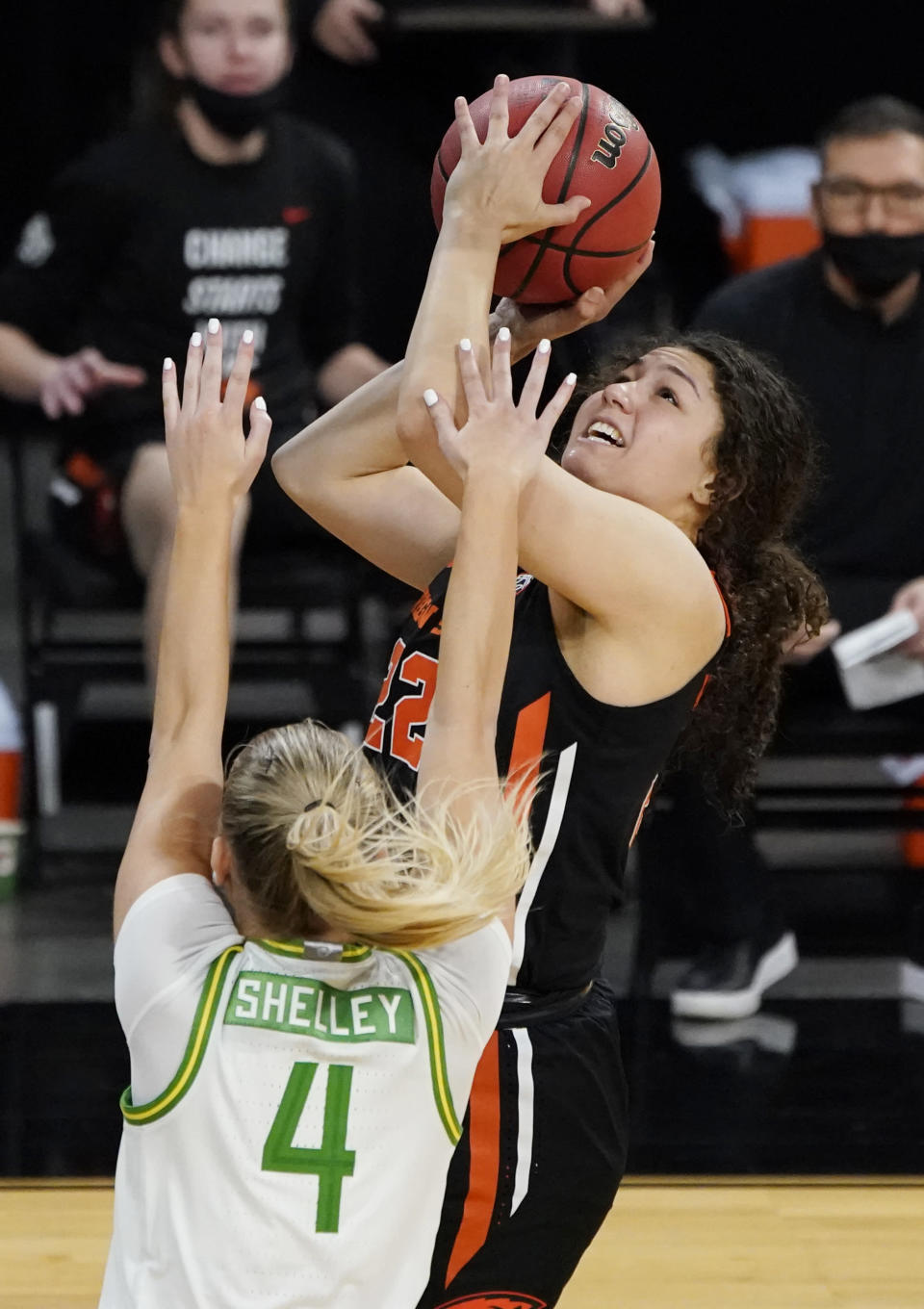 FILE - Oregon State's Talia Von Oelhoffen (22) shoots over Oregon's Jaz Shelley (4) during the second half of an NCAA college basketball game in the second round of the Pac-12 women's tournament in Las Vegas, in this Thursday, March 4, 2021, file photo. Players like Oregon State's Talia Von Oelhoffen are not only gaining a head start and valuable experience in their college basketball careers as early enrollees out of high school, they have been counted upon to help women's teams across the country keep their seasons going when players are held out for COVID-19 protocols. Now, some will make their March Madness debuts on the stage in the NCAA Tournament. (AP Photo/John Locher, File)