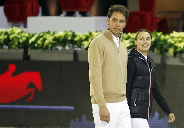 FILE - In this Dec. 1, 2011 file picture former tennis player Martina Hingis of Switzerland, right, and her husband Thibault Hutin walk prior a show jumping event at Villepinte, north of Paris. Martina Hingis has been questioned by Swiss police after her estranged husband said he was attacked by the five-time Grand Slam champion and her family. Schwyz canton police spokesman Florian Grossmann says Wednesday Oct 30, 2013 Hingis,her mother Melanie Molitor and her mother's boyfriend Mario Widmer were interviewed at its headquarters last week. Grossmann tells The Associated Press the canton justice department will decide possible further action. No timetable was set for a decision. French equestrian athlete Thibault Hutin has said he was attacked on Sept. 23 at his home in Feusisberg. Hutin claimed Hingis and Molitor hit him, and Widmer struck him with a DVD player. (AP Photo/Francois Mori, File)