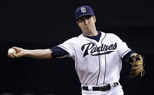 San Diego Padres second baseman Jedd Gyorko throws to first to get the out on Milwaukee Brewers' Jean Segura in the first inning of a baseball game in San Diego, Wednesday, April 24, 2013. (AP Photo/Lenny Ignelzi)