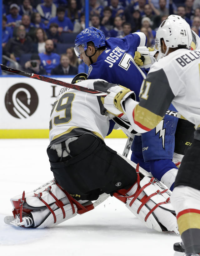 Tampa Bay Lightning right wing Mathieu Joseph runs into Vegas Golden Knights goaltender Marc-Andre Fleury (29) as he scores a goal during the second period of an NHL hockey game Tuesday, Feb. 5, 2019, in Tampa, Fla. (AP Photo/Chris O'Meara)