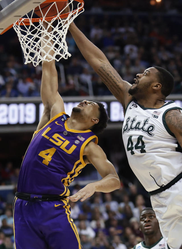 LSU guard Skylar Mays (4) has his shot blocked by Michigan State forward Nick Ward (44) during the second half of a semifinal in the NCAA men's college basketball tournament East Region in Washington, Friday, March 29, 2019. (AP Photo/Alex Brandon)
