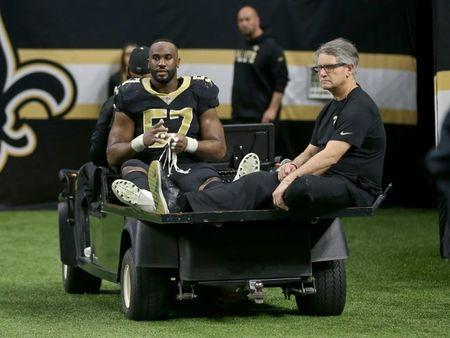 Nov 19, 2017; New Orleans, LA, USA; New Orleans Saints defensive end Alex Okafor (57) is taken off the field on a cart after an injury in the second half against the Washington Redskins at the Mercedes-Benz Superdome. The Saints won, 34-31 in overtime. Chuck Cook-USA TODAY Sports