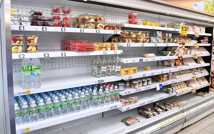 Mandatory Credit: Photo by FACUNDO ARRIZABALAGA/EPA-EFE/Shutterstock (12226490c) Food yet to be shelved at a supermarket in London, Britain, 22 July 2021. British supermarkets are struggling to stock shelves as staff shortages take their toll due to the so called 'pingdemic'. With so many staff going into self isolation after being pinged by the NHS app, supermarkets are now under increasing pressure to keep shelves fully stocked. The British government is being urged to allow supermarket staff to be exempt from self-isolation rules. Pingdemic in the UK, London, United Kingdom - Shutterstock