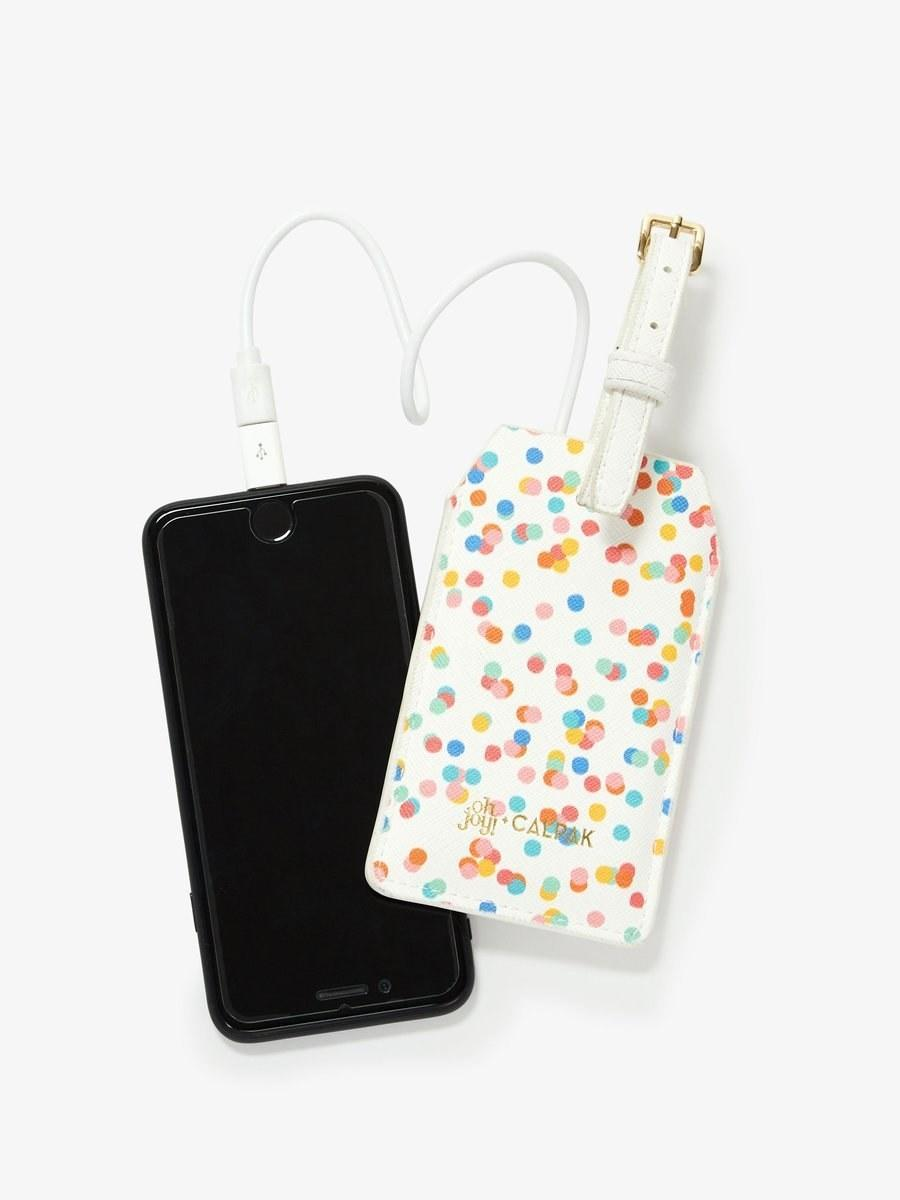"""$32, Calpak. <a href=""""https://www.calpaktravel.com/collections/accessories/products/oh-joy-power-luggage-tag?variant=23682545418298"""" rel=""""nofollow noopener"""" target=""""_blank"""" data-ylk=""""slk:Get it now!"""" class=""""link rapid-noclick-resp"""">Get it now!</a>"""