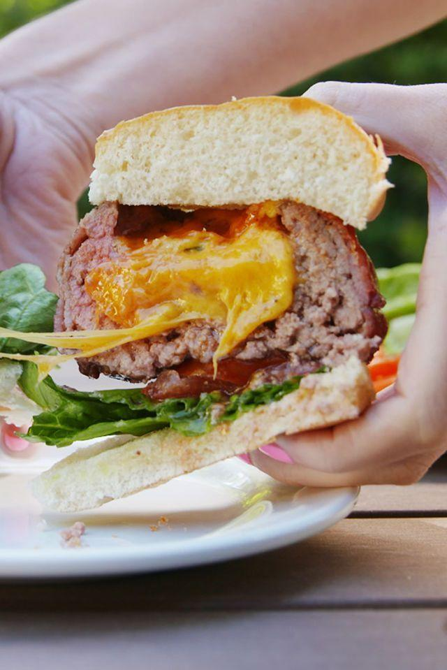 """<p>Just when you thought burgers couldn't get any better ...</p><p>Get the <a href=""""https://www.delish.com/uk/cooking/recipes/a34490847/beer-can-burgers-recipe/"""" rel=""""nofollow noopener"""" target=""""_blank"""" data-ylk=""""slk:Beer Can Burgers"""" class=""""link rapid-noclick-resp"""">Beer Can Burgers</a> recipe.</p>"""