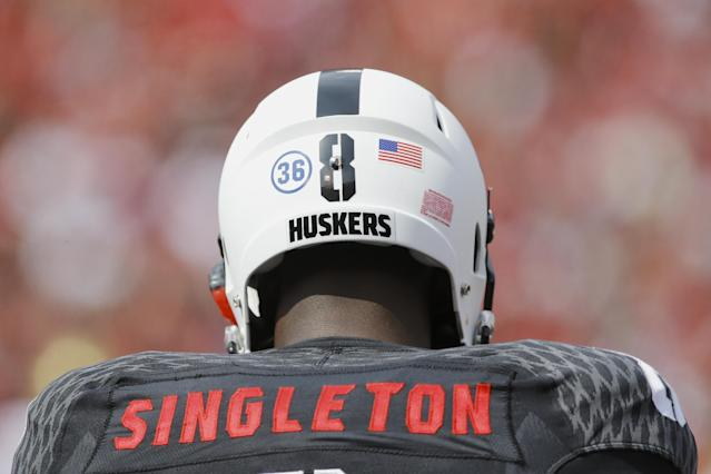 Nebraska defensive back D.J. Singleton (8) has a 36 sticker on the back of his helmet as he and the whole Nebraska team honor UCLA wide receiver Nick Pasquale (36) who was killed earlier in the week in the first half of an NCAA college football game against UCLA, in Lincoln, Neb., Saturday, Sept. 14, 2013. (AP Photo/Nati Harnik)