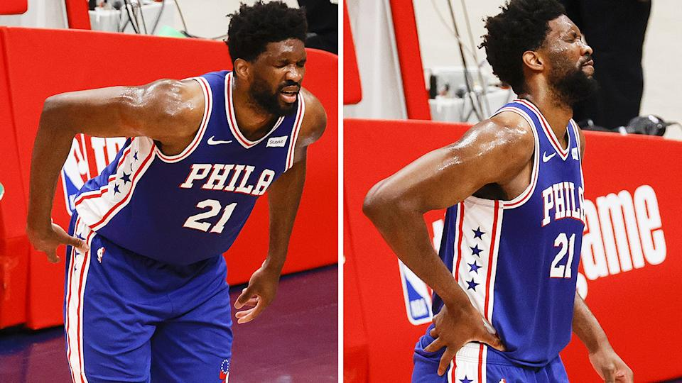 Joel Embiid grimaces in pain after a nasty fall while playing against the Washington Wizards.