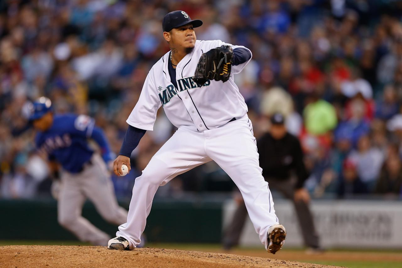 SEATTLE, WA - MAY 25:  Starting pitcher Felix Hernandez #34 of the Seattle Mariners pitches against the Texas Rangers at Safeco Field on May 25, 2013 in Seattle, Washington.  (Photo by Otto Greule Jr/Getty Images)