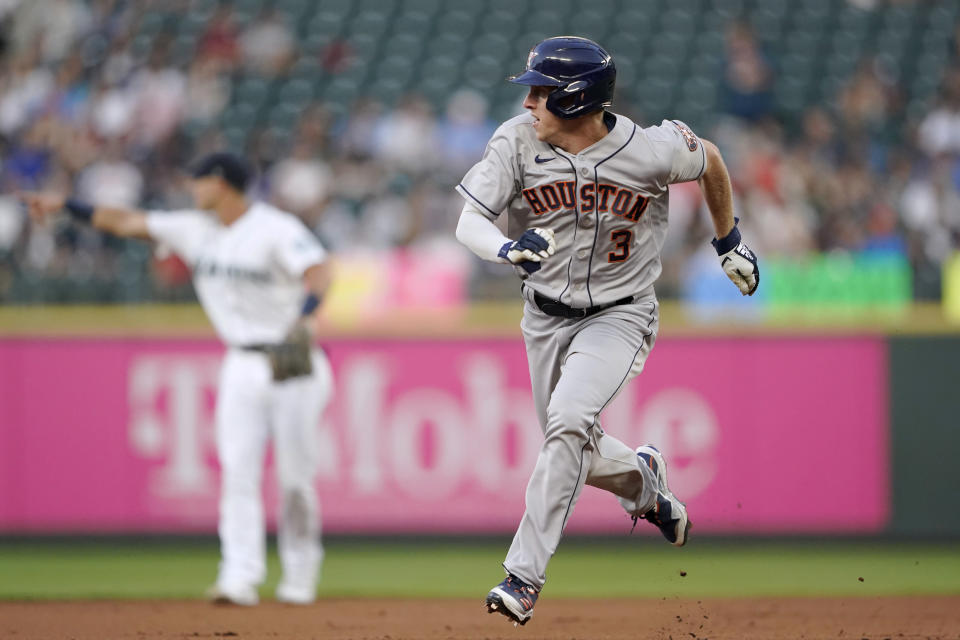 Houston Astros' Myles Straw takes off from second base to score on a double by Martin Maldonado during the fourth inning of the team's baseball game against the Seattle Mariners, Tuesday, July 27, 2021, in Seattle. (AP Photo/Ted S. Warren)
