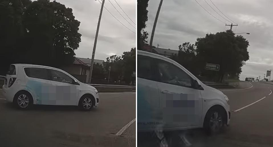 A white hatchback and another car crash on a roundabout at Wallsend in NSW.