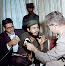 <p>Fidel Castro, seated during interview in February 1959. (AP Photo) </p>