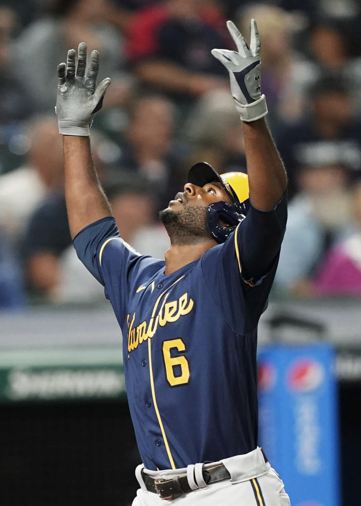 Milwaukee Brewers' Lorenzo Cain celebrates a grand slam during the fifth inning of the team's baseball game against the Cleveland Indians, Friday, Sept. 10, 2021, in Cleveland. (AP Photo/Tony Dejak)