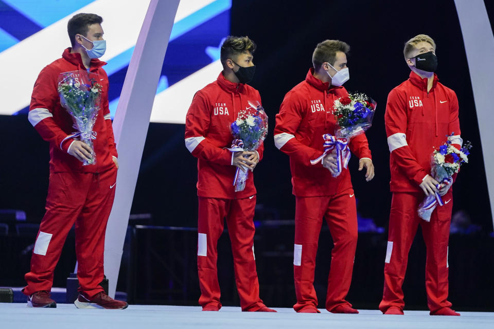 Members of the US Men's Olympic Team, Brody Malone, Yul Moldauer, Sam Mikulak and Shane Wiskus (L-R) stand 0 stage after the men's U.S. Olympic Gymnastics Trials Saturday, June 26, 2021, in St. Louis. (AP Photo/Jeff Roberson)