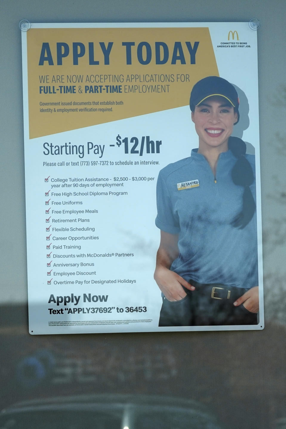 A hiring information sign is displayed at a fast food restaurant in Des Plaines, Ill., Friday, April 2, 2021. America's employers unleashed a burst of hiring in March, adding 916,000 jobs in a sign that a sustained recovery from the pandemic recession is taking hold as vaccinations accelerate, stimulus checks flow through the economy and businesses increasingly reopen. (AP Photo/Nam Y. Huh)