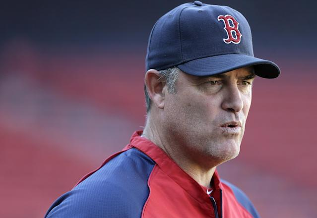 Boston Red Sox manager John Farrell walks in front of the dugout during a baseball workout at Fenway Park in Boston, Tuesday, Oct. 1, 2013. The Red Sox host Game 1 of the AL divisional series on Friday, Oct. 4, against the winner of Wednesday's wild-card playoff game between the Cleveland Indians and Tampa Ray Rays. (AP Photo/Steven Senne)