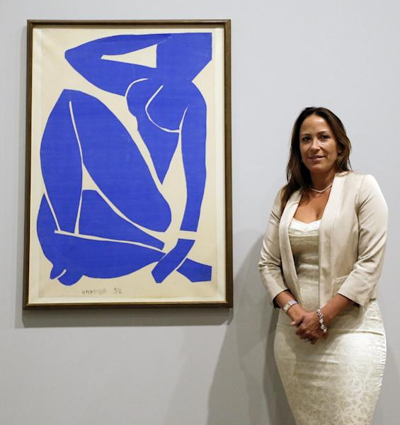 Sophie Matisse, the great-granddaughter of Henri Matisse, stands alongside his work 'Blue Nude III 1952' at The Tate Modern in London, Monday, April 14, 2014. The artworks are part of the 'Henri Matisse: The Cut-Outs' exhibition that runs at the gallery from April 17 until Sept. 7, 2014.(AP Photo/Kirsty Wigglesworth)