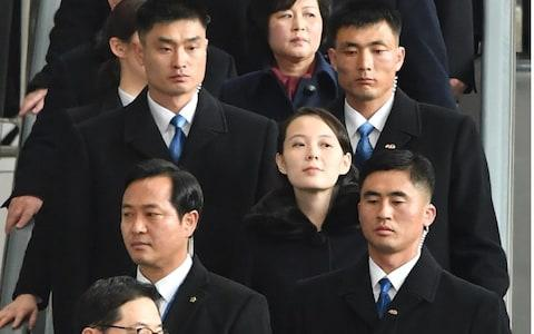 Security staff accompany Kim Yo-jong - Credit: YONHAP/AFP PHOTO/GETTY IMAGES