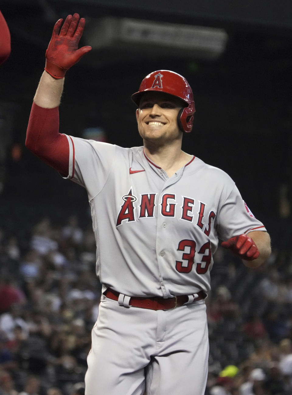 Los Angeles Angels' Max Stassi reacts after hitting a two run home run against the Arizona Diamondbacks in the first inning during a baseball game, Sunday, June 13, 2021, in Phoenix. (AP Photo/Rick Scuteri)