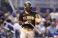 San Diego Padres' Fernando Tatis Jr. reacts after striking out during the eighth inning of a baseball game against the Miami Marlins, Sunday, July 25, 2021, in Miami. (AP Photo/Lynne Sladky)