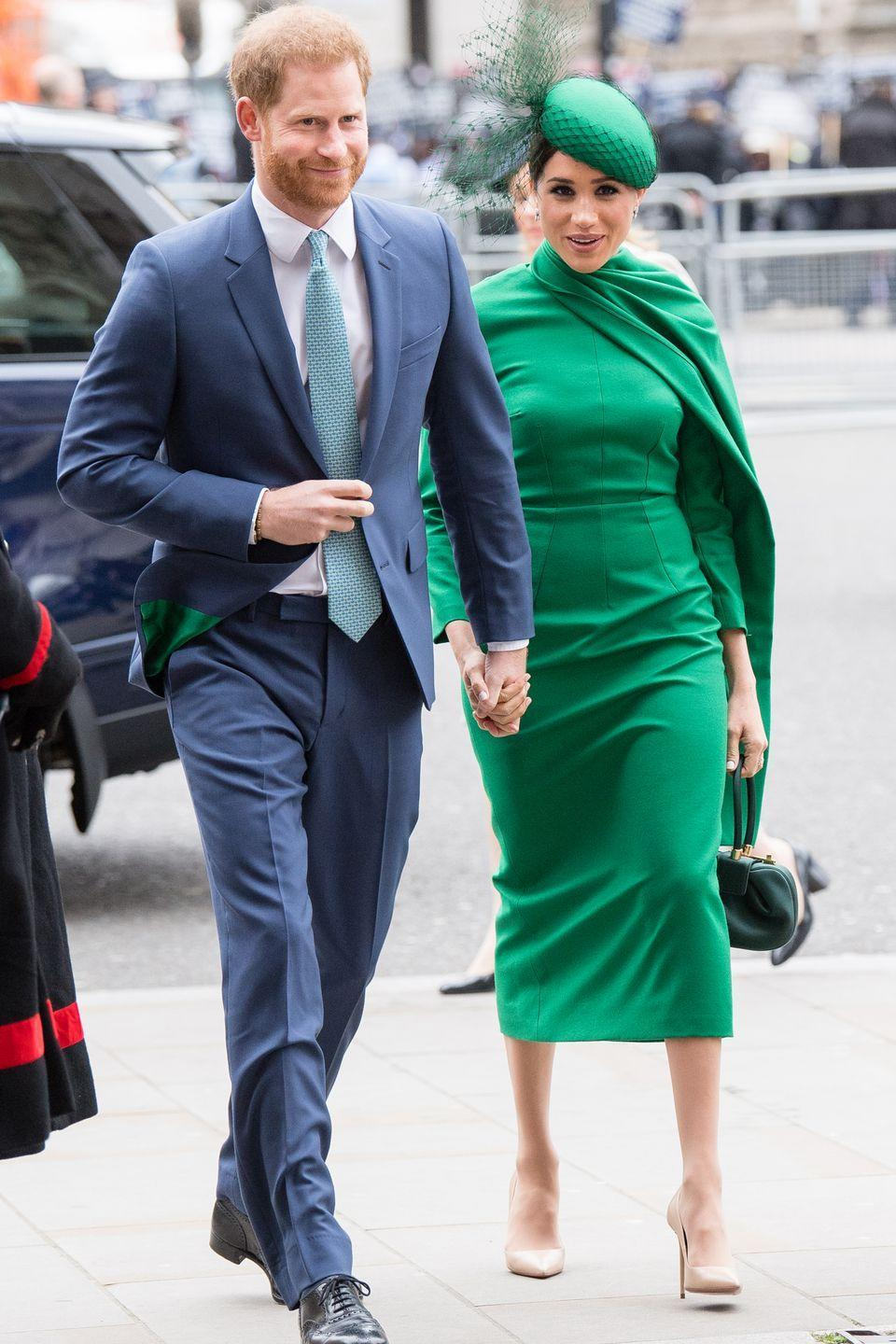 <p>Meghan and Harry hold hands as they stroll into the 2020 Commonwealth Day Service.</p>