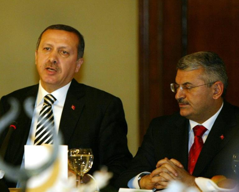 Turkish leader Recep Tayyip Erdogan (left) and Binali Yildirim attend a 2006 reception at the Dolmabahce Palace in Istanbul