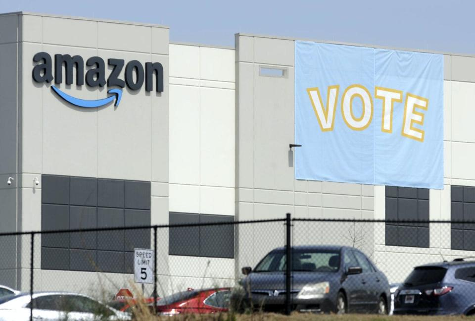 A banner outside an Amazon facility encourages workers to vote for unionization.