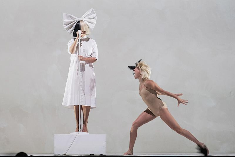 Sia and Maddie Ziegler perform on stage during the opening night of her 'Nostalgic for the Present' tour at KeyArena on September 29, 2016 in Seattle, Washington. (Mat Hayward via Getty Images)
