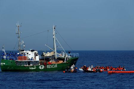 Rescue NGOs Sea-Eye, Migrant Offshore Aid Station (MOAS) and Jugend Rettet Iuventa carry out a joint rescue operation as some 20 migrants drowned in the central Mediterranean in international waters off the coast of Libya, April 16, 2017.    REUTERS/Darrin Zammit Lupi