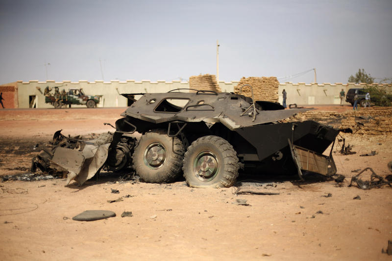 In this image taken during an official visit organized by the Malian army to the town of Konna, some 680 kilometers (430 miles) north of Mali's capital Bamako, Saturday, Jan. 26, 2013, a Malian army armored vehicle used by islamist rebels stands charred. One wing of Mali's Ansar Dine rebel group has split off to create its own movement, saying that they want to negotiate a solution to the crisis in Mali, in a declaration that indicates at least some of the members of the al-Qaida linked group are searching for a way out of the extremist movement in the wake of French air strikes. (AP Photo/Jerome Delay)