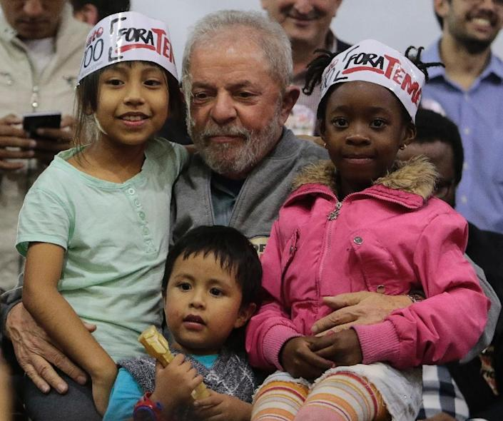 Former Brazilian president Luiz Inacio Lula da Silva (pictured) presided over an economic boom and was hailed internationally for social welfare policies that helped lift millions of people out of poverty (AFP Photo/Miguel Schincariol)